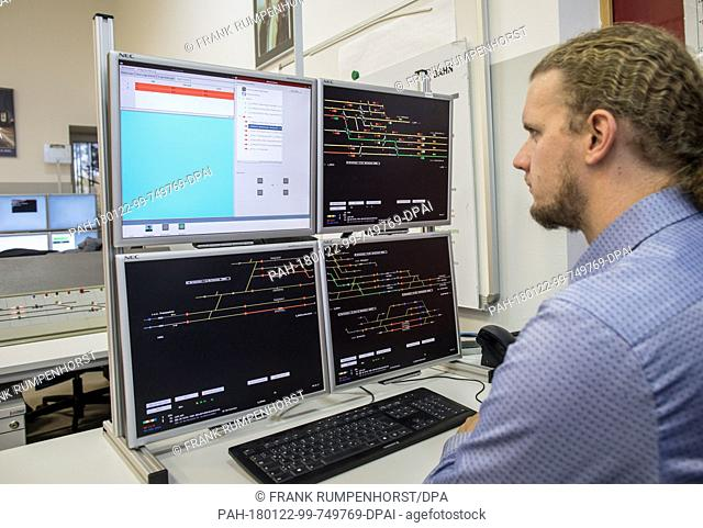 Christoph Krauß, department manager at the Fraunhofer Institute, works on an digital interlocking system in the railway company of Darmstadt, Germany
