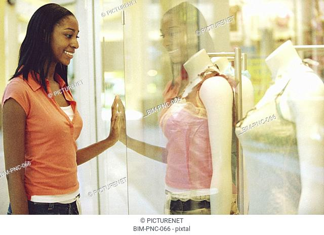 Woman looking at store window merchandise