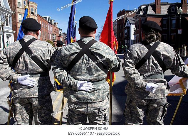 Backs of US Military Honor Guard at ease, St. Patrick's Day Parade, 2014, South Boston, Massachusetts, USA