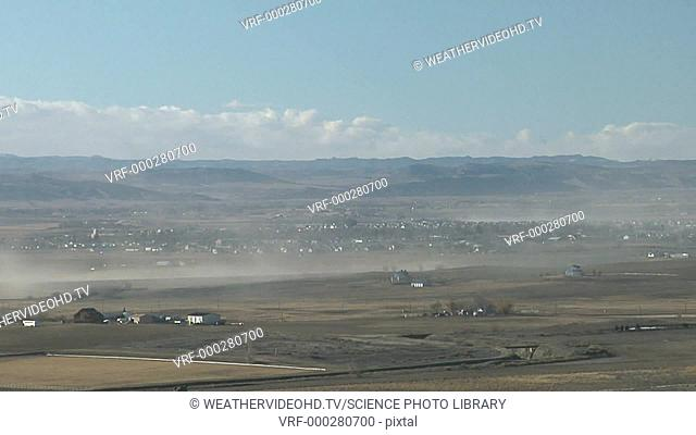 Timelapse footage of a dust storm formed when strong downslope winds in the lee of Rocky Mountains pick up loose soil and scatter it