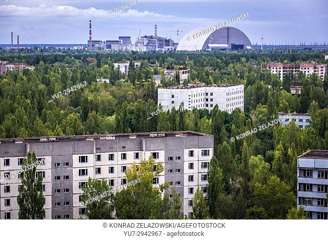 Aerial view of Pripyat ghost city, Ukraine. View with New Safe Confinement of Chernobyl Nuclear Power Plant