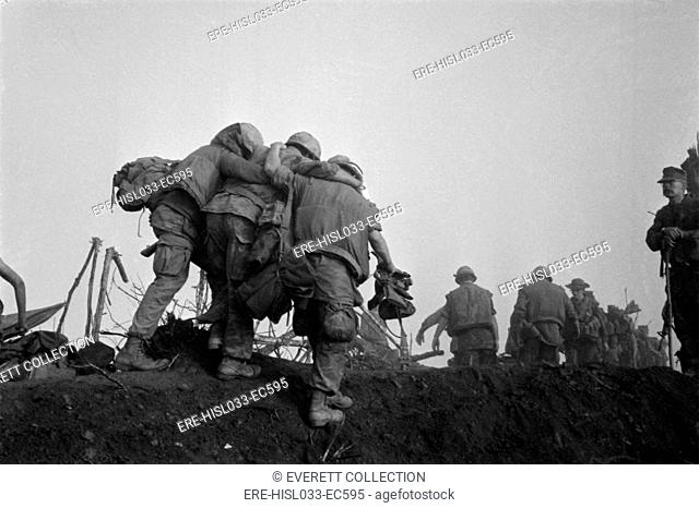 Vietnam War. A US Marine is helped to an evacuation point after he was wounded during Operation Dewey Canyon. He was one of 924 Marines casualties 121 killed...