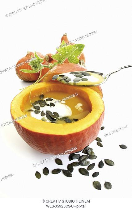 Pumpkin cream soup in pumpkin half, pumpkin seeds
