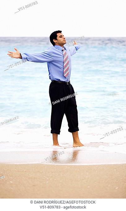 Executive feeling free by the sea