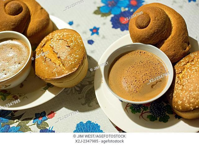 San Sebastian Abasolo, Oaxaca, Mexico - Chocolate de Agua, traditionally drunk from a small bowl, with Marquezote (with sesame seeds) and Pan de Cazuela