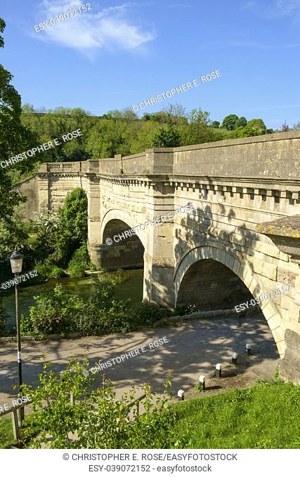 Historic Avoncliff Aqueduct carries the Kennet and Avon Canal over the River Avon and the Bath to Westbury railway line, at Avoncliff in Wiltshire, England