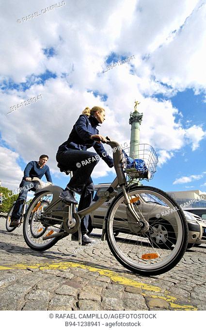 Urban cyclists, Place de la Bastille, Paris, France