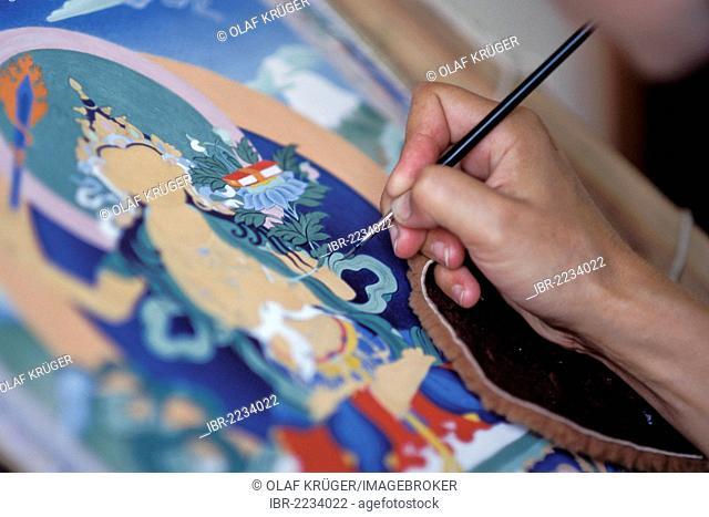 Hand of a Thangka painter, holding brushes, Tibetan Buddhism, Dharamsala, McLeod Ganj, Himachal Pradesh, Himalayas, India, Asia