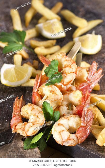 Street food presentation of shrimp and fried skewer