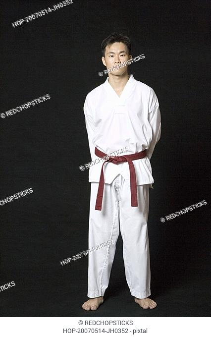 Portrait of a young man standing in gi