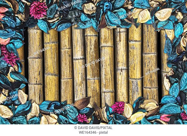 Beautiful and colorful background of Ocean Scent potpourri with copy space and a bamboo background