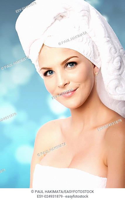 Beautiful clean happy woman with hair wrapped in towels after shower bath, hygiene concept