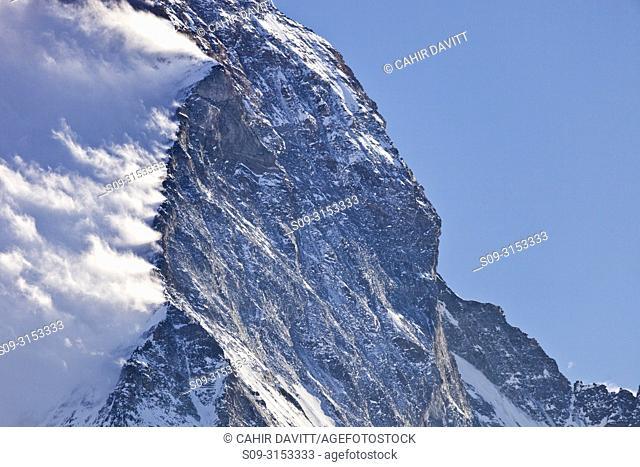 Switzerland, Canton du Valais, Zermatt, Blatten, Matterhorn Mountain, Hornli Ridge and East face with wind blown snow of the ridge