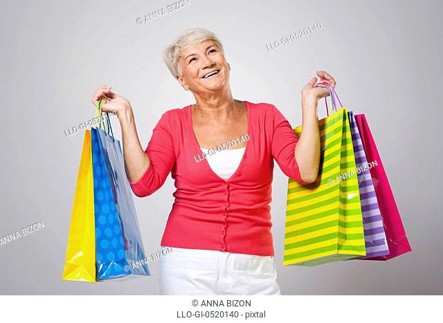 Beautiful smiling woman with shopping bags. Debica, Poland