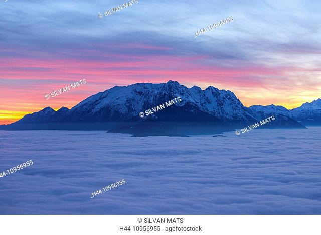 Sea of fog and snow-capped mountain in sunset with colorful sky in ticino Switzerland, Europe