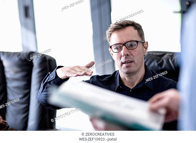 Business man explaining something in office meeting