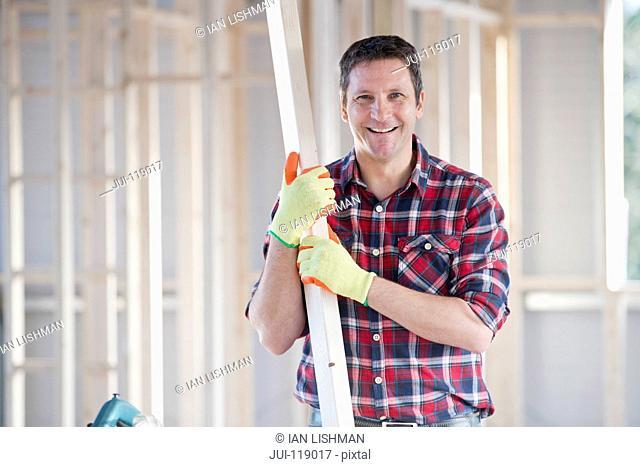 Portrait of carpenter on indoor building construction site