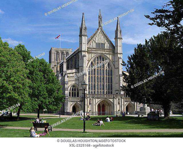 Winchester Cathedral WINCHESTER HAMPSHIRE People relaxing on