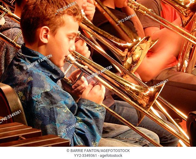 6th Grade Boy Playing Trombone in Band, Wellsville, New York, USA