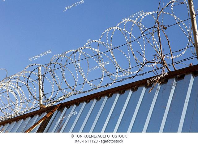 barbed wire fence to protect a house in kabul, Afghanistan