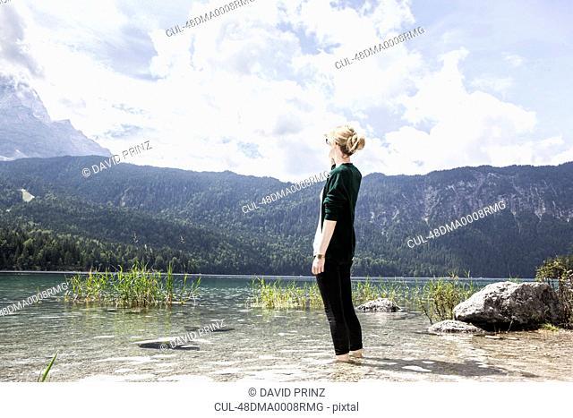 Woman standing in rural lake
