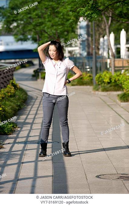 Japanese Girl poses on the street in Yokohama, Japan. Yokohama is a port city located in a bit south of Tokyo