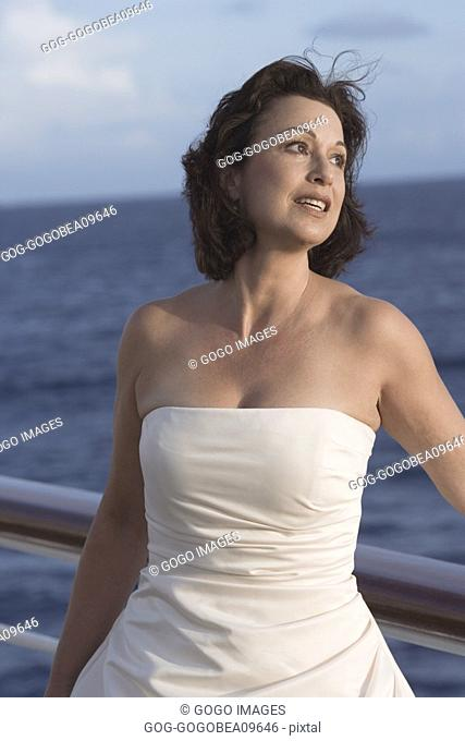 Woman standing on boat deck