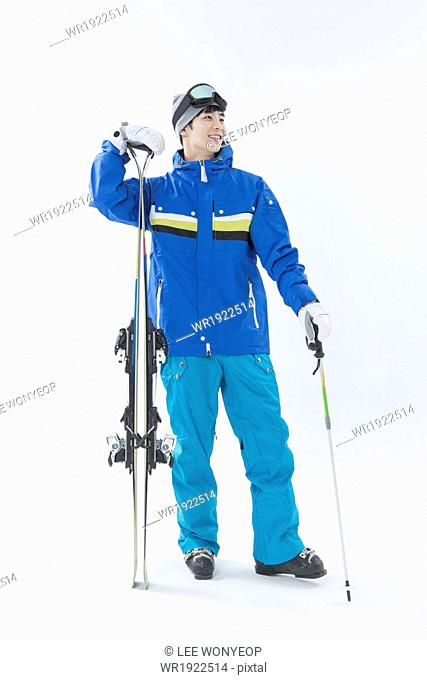 a man posing with skis
