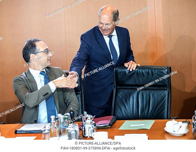 01 August 2018, Germany, Berlin: Olaf Scholz (SPD, M), Federal Minister of Finance, is welcomed by Heiko Maas (SPD), Foreign Minister