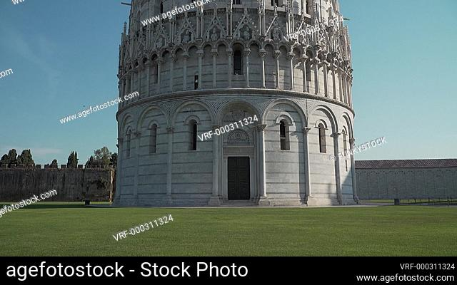 Baptistry of St. John, Pisa , Italy : pan up exterior of at sunrise