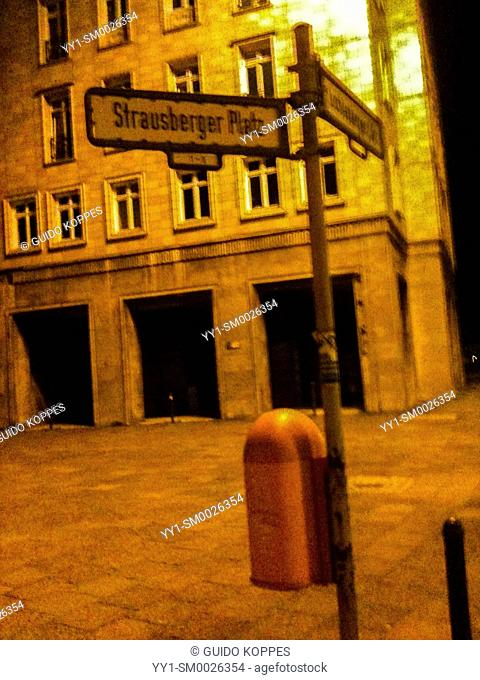 Berlin, Germany. Streetname Sign of Strausberger Platz during a dark evening