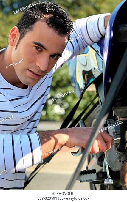 Man repairing motorcycle