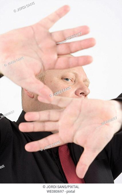 Middle-age man covering his face