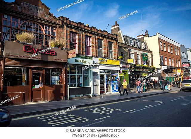 Row of shops and restaurants in Coldharbour Lane, Brixton, London, UK