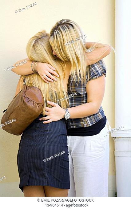 Two girls sorrow, hugging