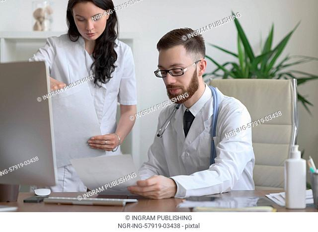 Two doctors discussing test results