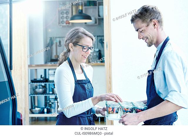 Colleagues in commercial kitchen preparing food