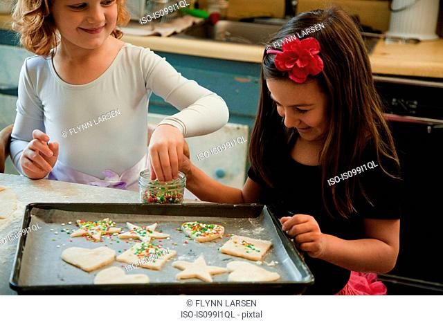 Girls in kitchen baking cookies