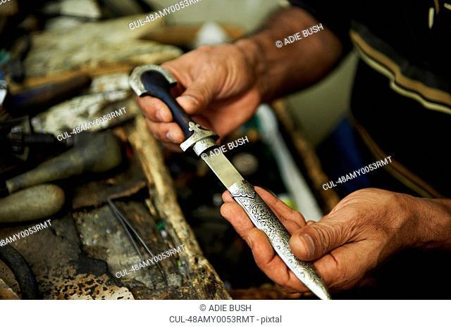 Artisan holding carving metal