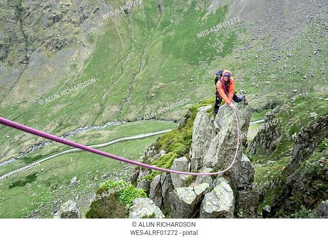 UK, Lake District, Longsleddale valley, Buckbarrow Crag, man climbing on rock