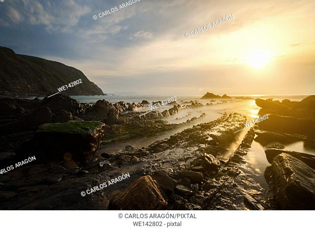 Flysch rocks in Barrika beach at the sunset, Basque Country, Spain