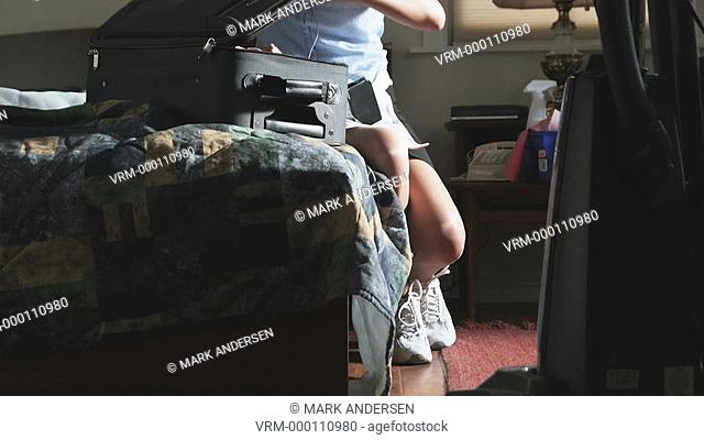 hotel maid going through a suitcase