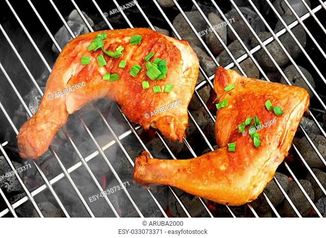 Barbecue Roast And Smoked Chicken Quarters On The Hot Charcoal Grill Background. Good Food For Outdoor Summer Barbecue Party Or Picnic