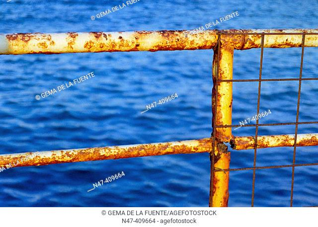 Rusty fence in front of sea
