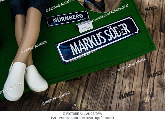 "30 March 2019, Bavaria, Nürnberg: A sign with the inscription """"Markus Söder"""" can be found in a CSU fan shop. In view of the upcoming European elections"