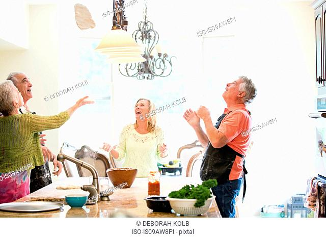 Group of seniors having fun in kitchen