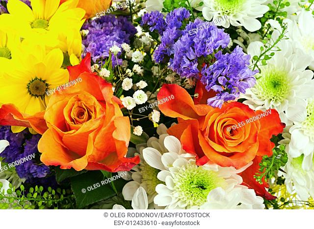 Beautiful bouquet of gerbera, roses and other flowers for use as background