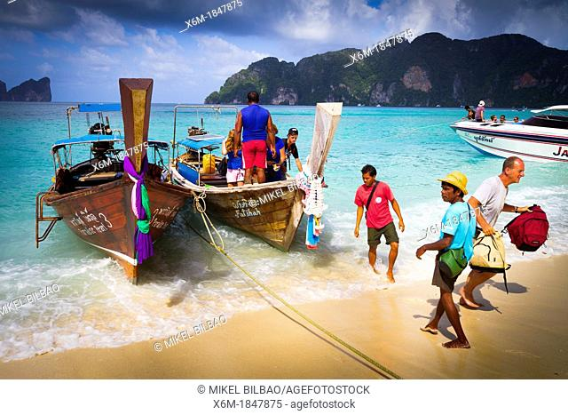 Longtail boat and tourists on Long beach  Phi Phi Don island  Krabi province, Andaman Sea, Thailand