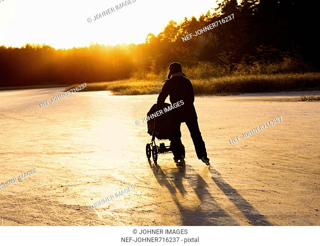 Father skating with a baby carriage, Sweden