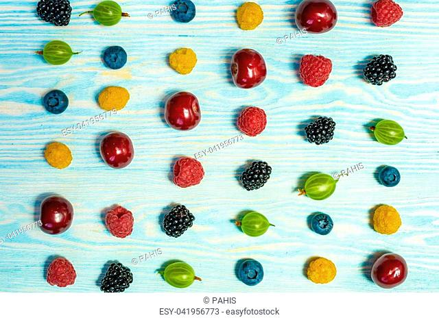 Collage of different fruits and berries isolated on white. Blueberries, cherries, blackberries, strawberries, currants. Top view